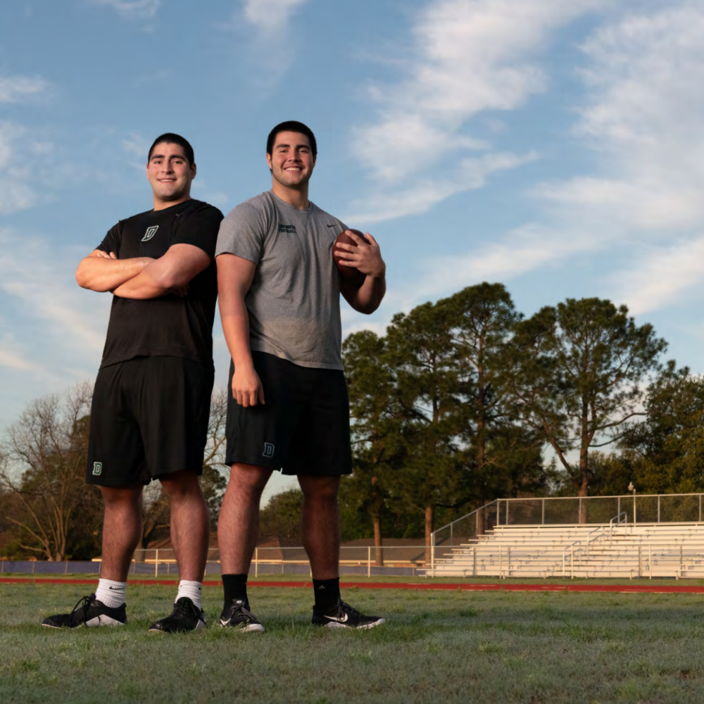 John Flores '22 and Michael Flores '23 on a football field