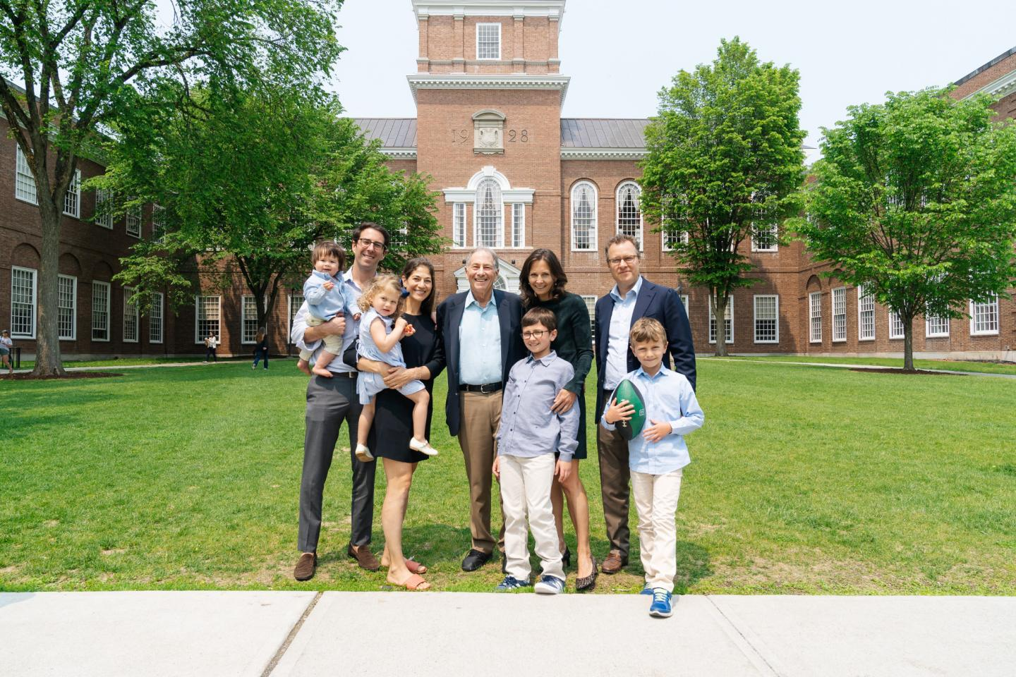 The Reiss family posing in front of Baker Library