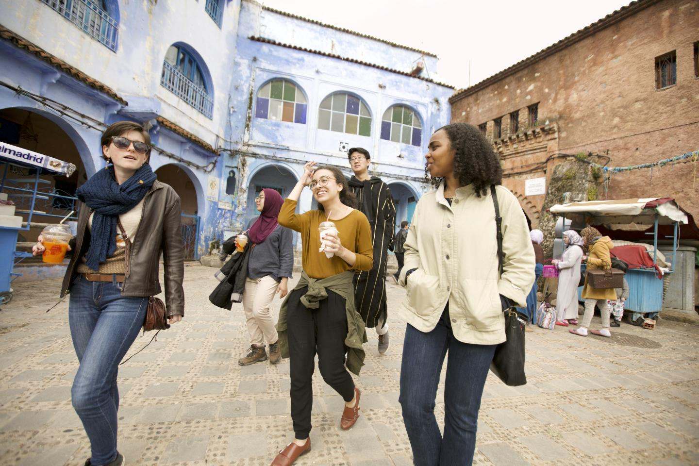 Students walk through a busy square in Morocco.