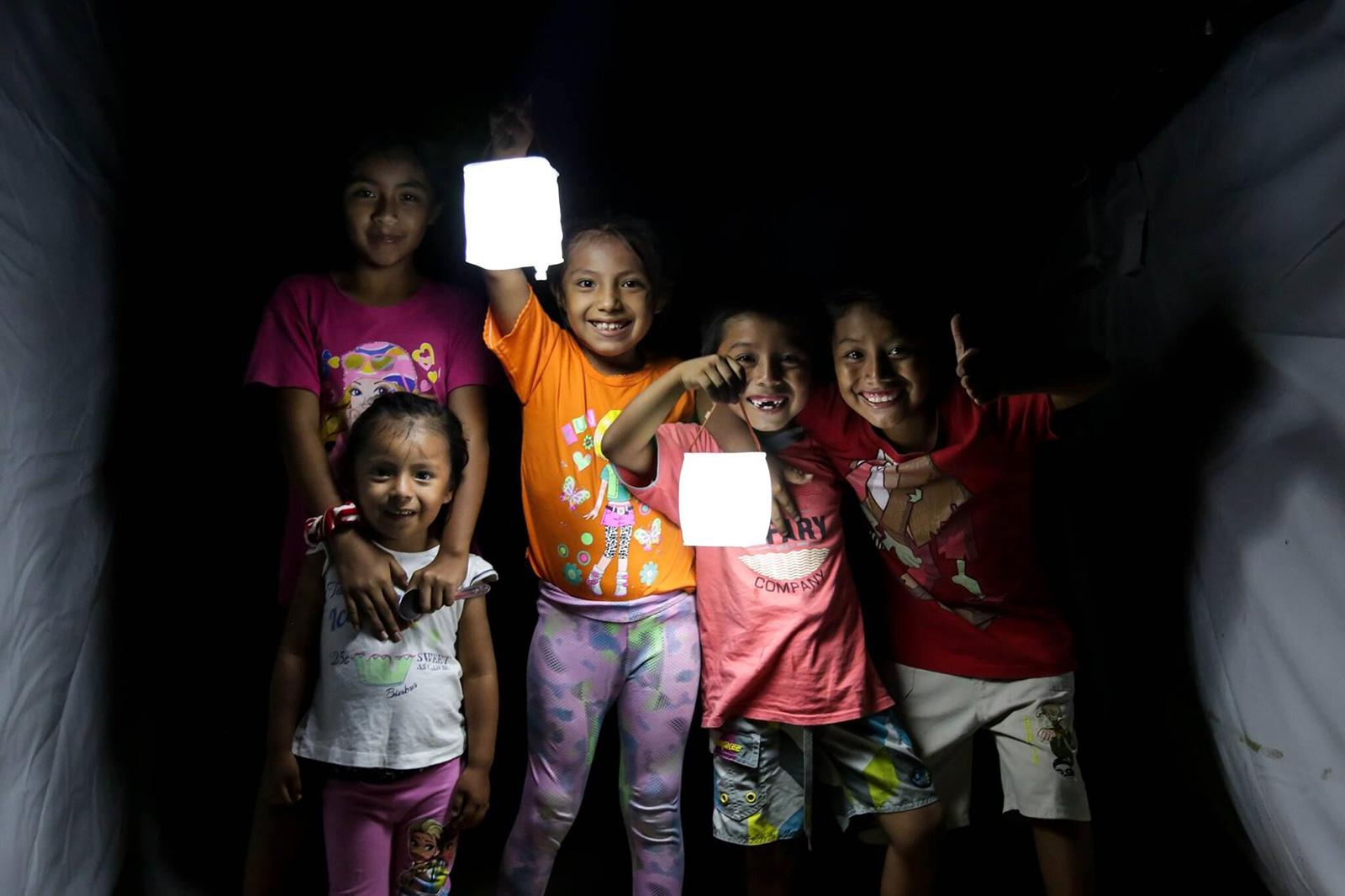 Children with LumenAid lanterns