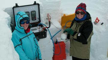 Thayer PhD student Alden Adolph '11 and Professor Mary Albert measure snow in an NSF-funded vernal window
