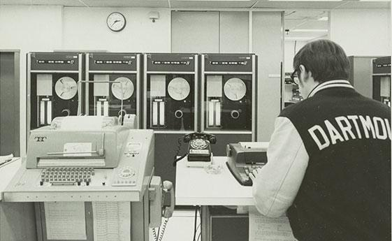 Man in a computer lab in the 1970's