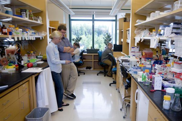 Faculty and students in a research lab