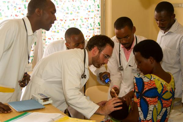 Dartmouth researchers with patients in Uganda