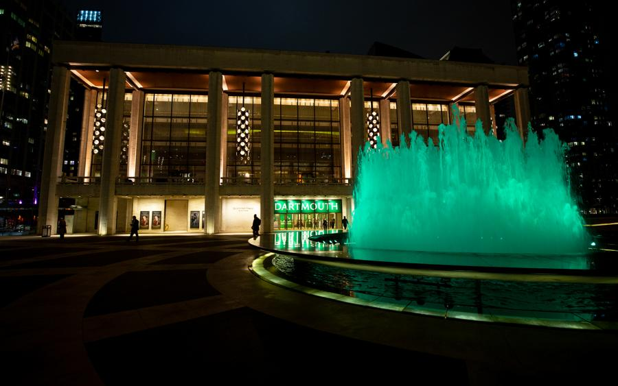 The fountain outside Lincoln Center, lit green for Dartmouth.